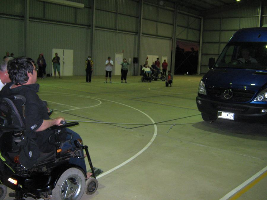 A young ABI handicapped pull a three tonne van